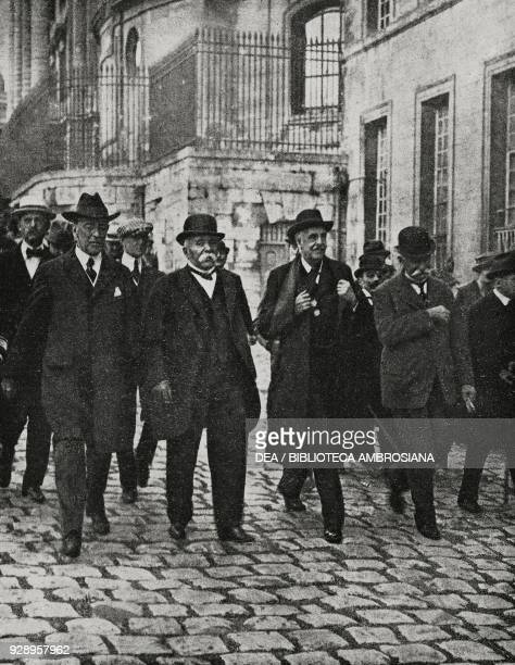 Thomas Woodrow Wilson , Georges Benjamin Clemenceau , Arthur James Balfour and Sidney Sonnino in Versailles to sign the peace treaty with Germany,...