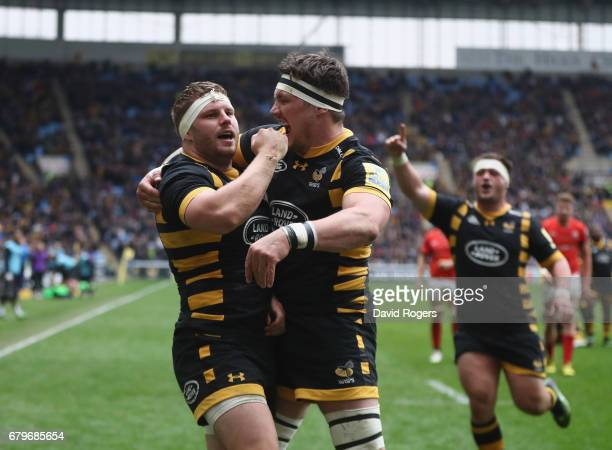 Thomas Young of Wasps celebrates with team mate Guy Thompson after scoring his third try during the Aviva Premiership match between Wasps and...