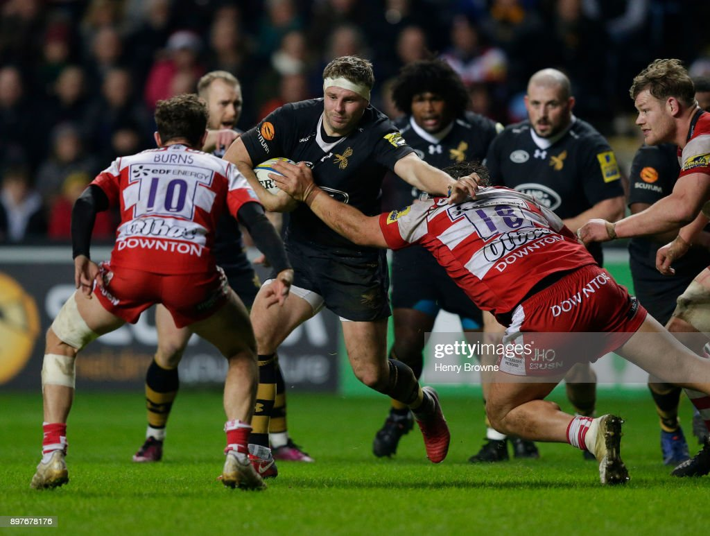 Thomas Young of Wasps tackled by Josh Hohneck of Gloucester during the Aviva Premiership match between Wasps and Gloucester Rugby at The Ricoh Arena on December 23, 2017 in Coventry, England.