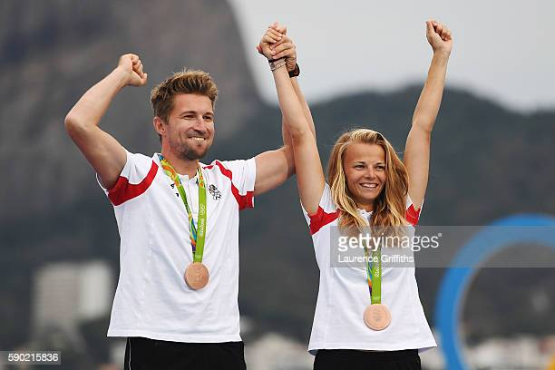 Thomas Zajac of Austria and Tanja Frank of Austria celebrate winning the bronze medal for the Nacra 17 Mixed class on Day 11 of the Rio 2016 Olympic...