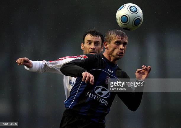 Thomas Zdebel of Leverkusen challenges Gennadi Blizniuk of Frankfurt during a friendly match between Bayer Leverkusen and FSV Frankfurt at Sueno Golf...