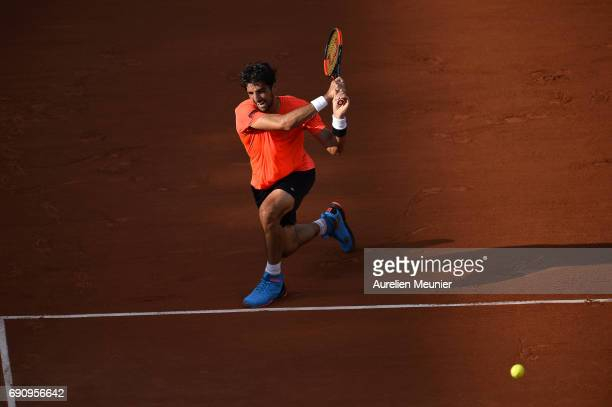 Thomaz Bellucci of Brasil plays a backhand during his men's single match against Lucas Pouille of France on day four of the 2017 French Open at...