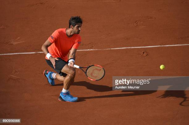 Thomaz Bellucci of Brasil plays a forehand during his men's single match against Lucas Pouille of France on day four of the 2017 French Open at...