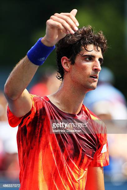 Thomaz Bellucci of Brazil celebrates defeating Yoshihito Nishioka of Japan during their Men's Singles Second Round match on Day Four of the 2015 US...
