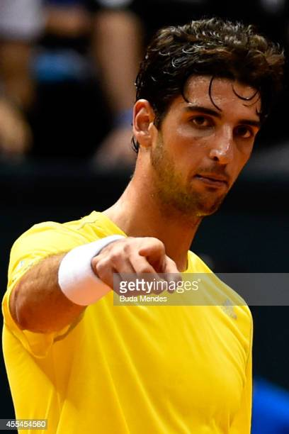 Thomaz Bellucci of Brazil gestures during his playoff singles match against Roberto Bautista Agut of Spain on Day Three of the Davis Cup at...