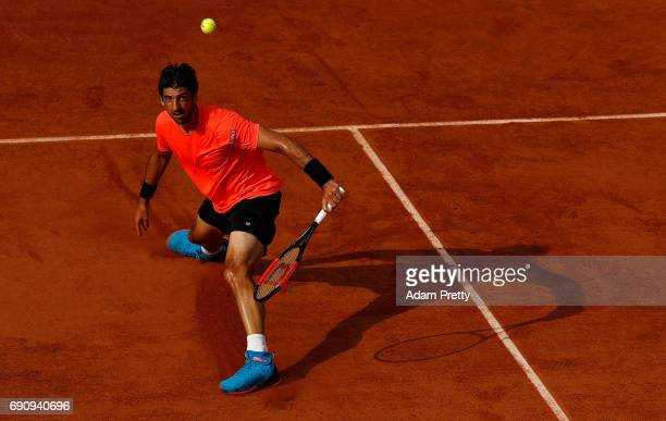 Thomaz Bellucci of Brazil hits a backhand during the second round match against Lucas Pouille of France on day four of the 2017 French Open at Roland...