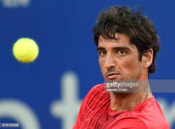 Thomaz Bellucci of Brazil looks at the ball during a second round match between Diego Schwartzman of Argentina and Thomaz Bellucci of Brazil as part...