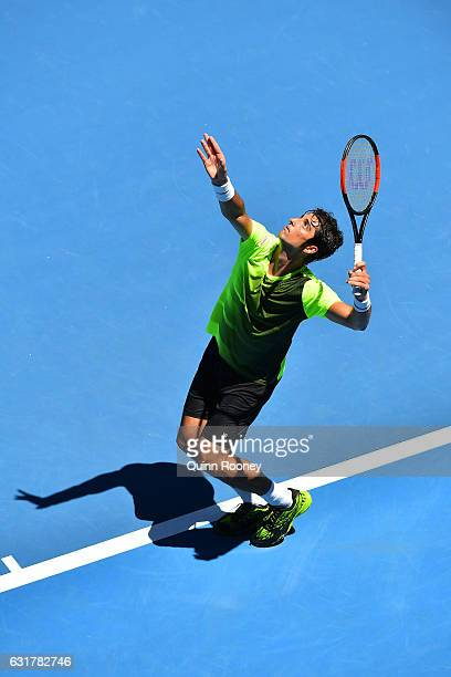 Thomaz Bellucci of Brazil plays a backhand in his first round match against Bernard Tomic of Australia on day one of the 2017 Australian Open at...