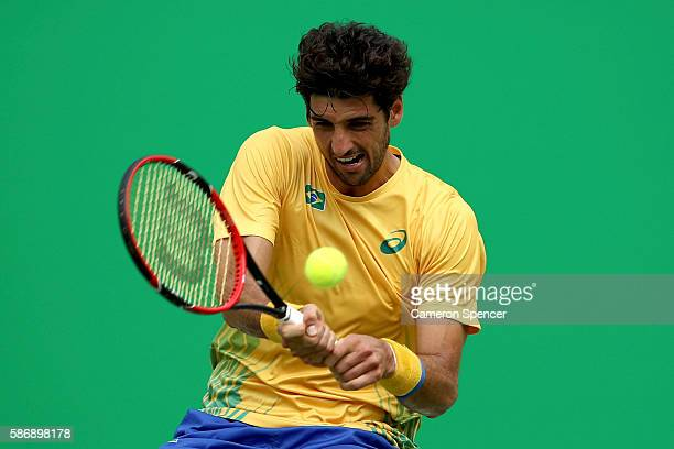 Thomaz Bellucci of Brazil plays a forehand against Dustin Brown of Germany in their first round match on Day 2 of the Rio 2016 Olympic Games at the...