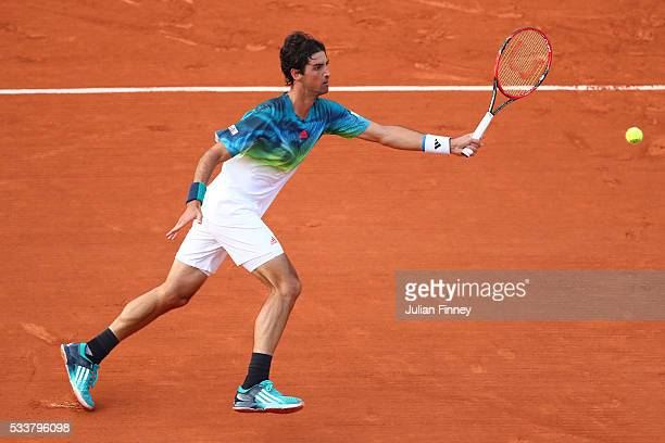 Thomaz Bellucci of Brazil plays a forehand during the Men's Singles first round match against Richard Gasquet of France on day two of the 2016 French...