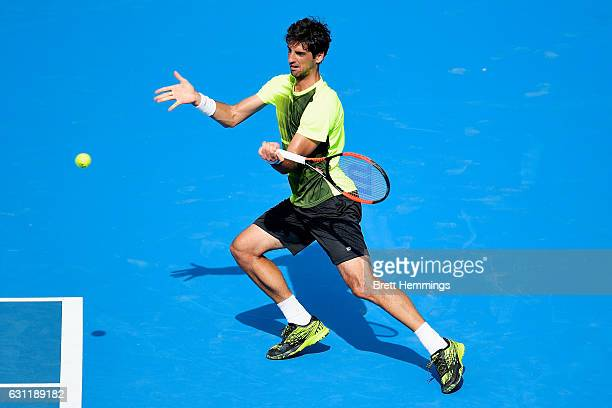 Thomaz Bellucci of Brazil plays a forehand shot in his final qualifying match against Nicolas Mahut of France during the 2017 Sydney International at...