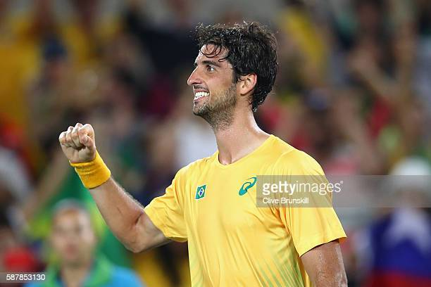 Thomaz Bellucci of Brazil reacts after defeating Pablo Cuevas of Uruguay in a Men's Singles Second Round match on Day 4 of the Rio 2016 Olympic Games...