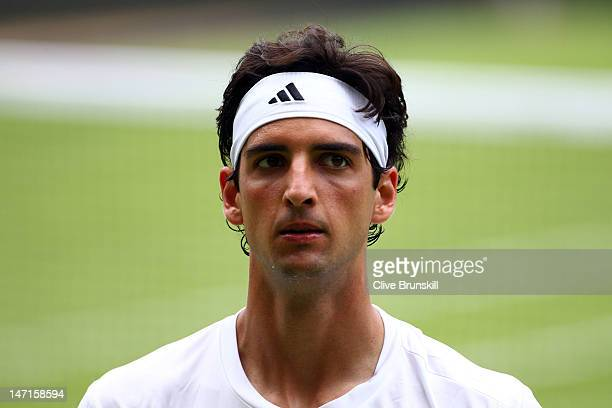 Thomaz Bellucci of Brazil reacts during his Gentlemen's Singles first round match against Rafael Nadal of Spain on day two of the Wimbledon Lawn...