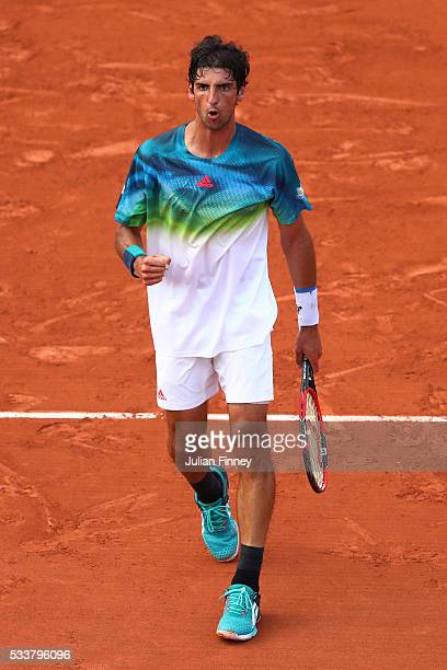 Thomaz Bellucci of Brazil reacts during the Men's Singles first round match against Richard Gasquet of France on day two of the 2016 French Open at...