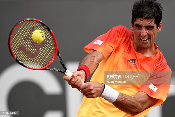 Thomaz Bellucci of Brazil returns a shot to Alexandr Dolgopolov of Ukraine during the Rio Open Day 2 at Jockey Club Brasileiro on February 16 2016 in...