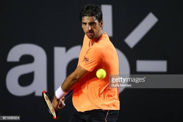Thomaz Bellucci of Brazil returns a shot to Fabio Fognini of Italy during the ATP Rio Open 2018 at Jockey Club Brasileiro on February 19 2018 in Rio...