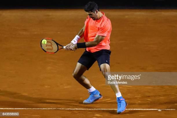 Thomaz Bellucci of Brazil returns a shot to Kei Nishikori of Japan during the ATP Rio Open 2017 at Jockey Club Brasileiro on February 21 2017 in Rio...