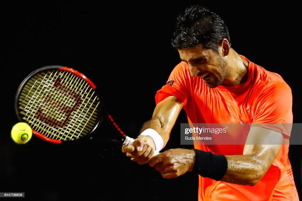 Thomaz Bellucci of Brazil returns a shot to Thiago Monteiro of Brazil during the ATP Rio Open 2017 at Jockey Club Brasileiro on February 23, 2017 in Rio de Janeiro, Brazil.