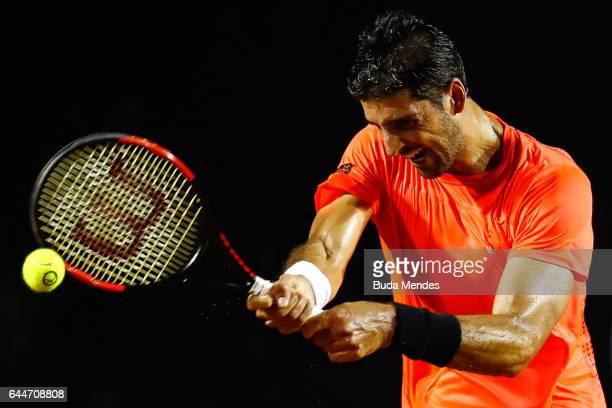 Thomaz Bellucci of Brazil returns a shot to Thiago Monteiro of Brazil during the ATP Rio Open 2017 at Jockey Club Brasileiro on February 23 2017 in...