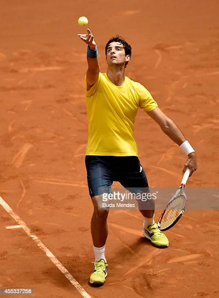 Thomaz Bellucci of Brazil serves against Pablo Andujar of Spain during their playoff singles match on Day One of the Davis Cup at Ibirapuera...