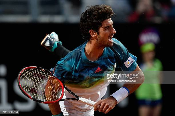 Thomaz Bellucci of Brazil serves in his match against Novak Djokovic of Serbia on Day Five of The Internazionali BNL d'Italia on May 12 2016 in Rome...