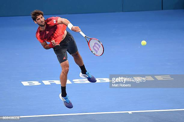 Thomaz Bellucci of Brazil serves in his match against offin of Belgium during day three of the 2016 Brisbane International at Pat Rafter Arena on...