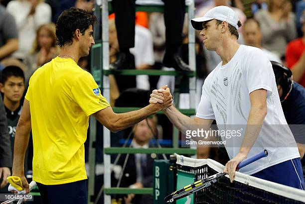 Thomaz Bellucci of Brazil shakes hands with Sam Querrey of the United States following their singles match during the Davis Cup first round between...