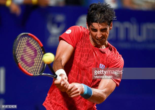 Thomaz Bellucci of Brazil takes a backhand shot during a second round match between Diego Schwartzman of Argentina and Thomaz Bellucci of Brazil as...