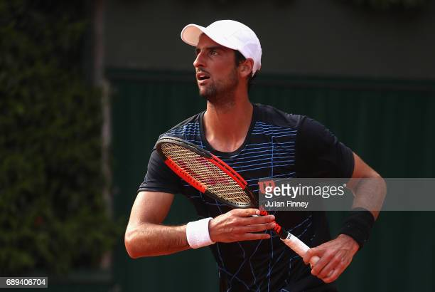 Thomaz Belucci of Brazil looks on during the mens singles first round match against Dusan Lajovic of Serbia on day one of the 2017 French Open at...
