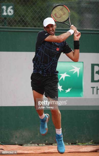 Thomaz Belucci of Brazil plays a forehand during the mens singles first round match against Dusan Lajovic of Serbia on day one of the 2017 French...