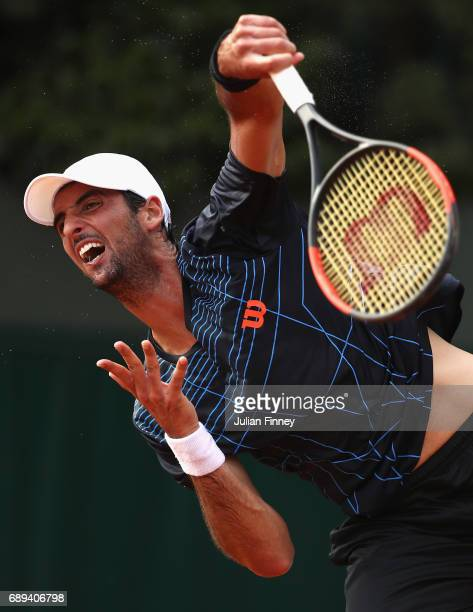 Thomaz Belucci of Brazil serves during the mens singles first round match against Dusan Lajovic of Serbia on day one of the 2017 French Open at...