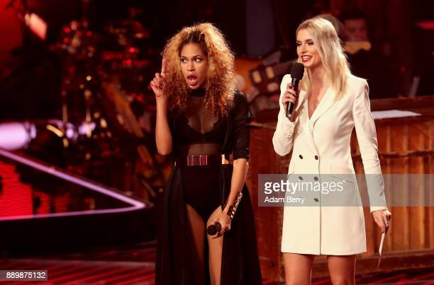 Thomaz reacts next to Lena Gercke as the former wins the 'The Voice of Germany' semifinals at Studio Berlin Adlershof on December 10 2017 in Berlin...