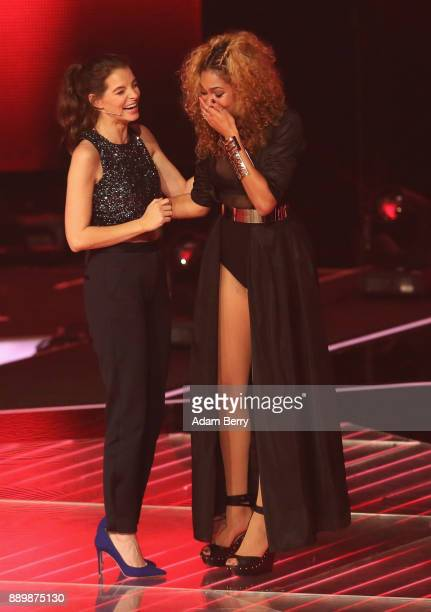 Thomaz reacts next to Yvonne Catterfeld as the former wins the 'The Voice of Germany' semifinals at Studio Berlin Adlershof on December 10 2017 in...