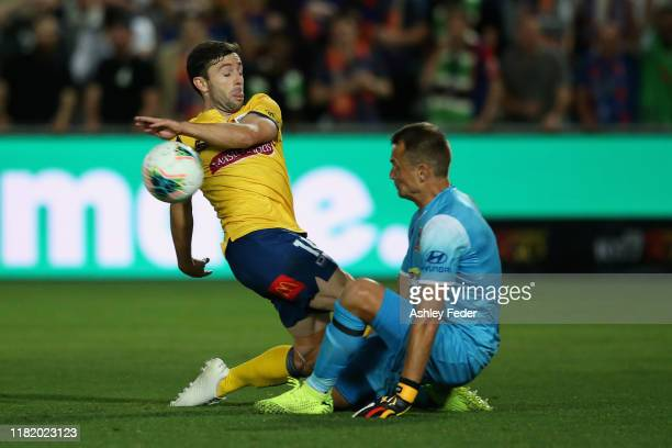 Thommy Oar of the Central Coast Mariners fails an attempt at goal blocked by Glen Moss of the Newcastle Jets during the round two A-League match...
