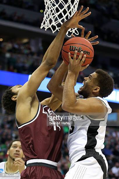 J Thompson of the Purdue Boilermakers shoots the ball over Mareik Isom of the Arkansas Little Rock Trojans during the first round of the 2016 NCAA...