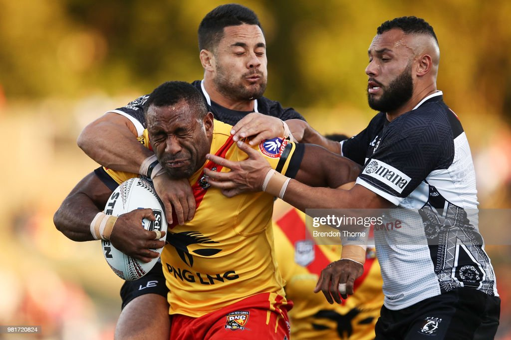 Thompson Teteh of PNG is tackled by the Fijian defence during the 2018 Pacific Test Invitational match between Fiji and Papua New Guinea at Campbelltown Sports Stadium on June 23, 2018 in Sydney, Australia.