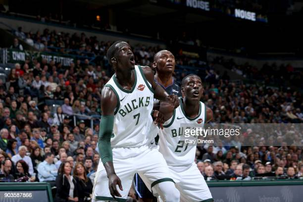 Thon Maker and Tony Snell of the Milwaukee Bucks boxes out against the Orlando Magic on January 10 2018 at the BMO Harris Bradley Center in Milwaukee...