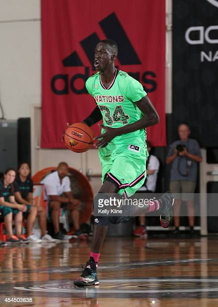 Thon Maker brings the ball up the court during the 2014 adidas Nations championship game between 2016 adidas US Lillard and 2016 US Wall on August 4...