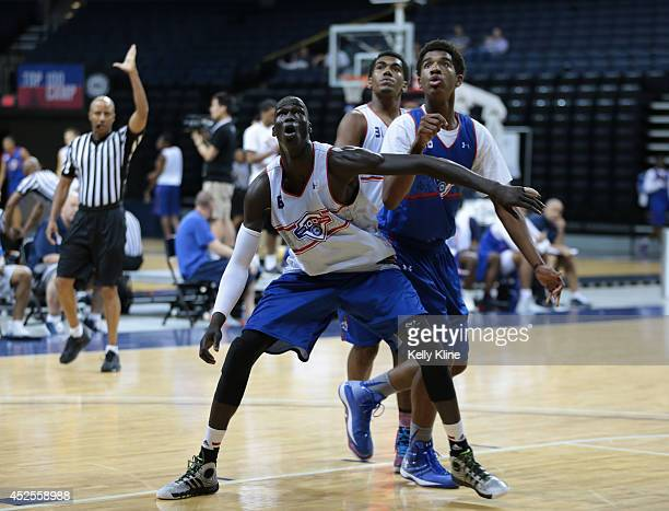 Thon Maker in white looks to rebound the ball during the National Basketball Players Association Top 100 Camp on June 20 2014 at John Paul Jones...