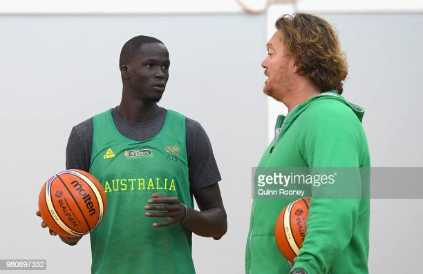 Thon Maker of the Boomers speaks to assistant coach Luc Longley during an Australian Boomers training session at Melbourne Sports and Aquatic Centre...