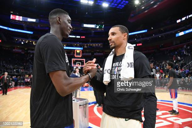 Thon Maker of the Detroit Pistons and George Hill of the Milwaukee Bucks hi-five after a game on February 20, 2020 at Little Caesars Arena in...