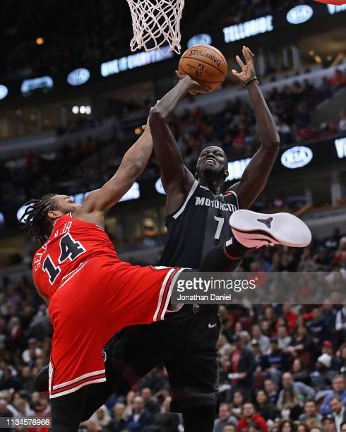 Thon Maker of the Detroit Pistons is fouled by Wayne Selden of the Chicago Bulls at the United Center on March 08 2019 in Chicago Illinois NOTE TO...