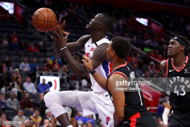 Thon Maker of the Detroit Pistons tries to get off a shot next to Kyle Lowry of the Toronto Raptors during the first half at Little Caesars Arena on...