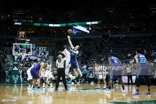Thon Maker of the Milwaukee Bucks and Cody Zeller of the Charlotte Hornets leap for the jump ball in the first quarter at BMO Harris Bradley Center...