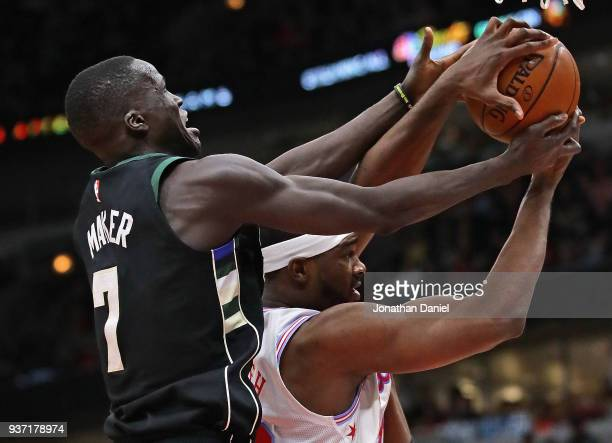 Thon Maker of the Milwaukee Bucks and Noah Vonleh of the Chicago Bulls battle for a rebound at the United Center on March 23 2018 in Chicago Illinois...