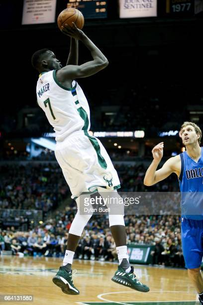 Thon Maker of the Milwaukee Bucks attempts a shot while being guarded by Dirk Nowitzki of the Dallas Mavericks in the second quarter at BMO Harris...