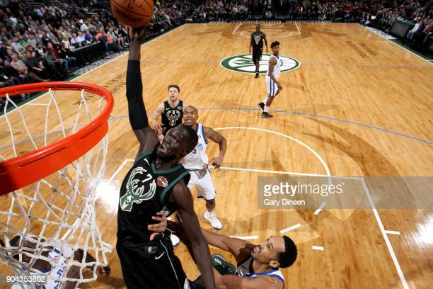 Thon Maker of the Milwaukee Bucks drives to the basket against the Golden State Warriors on January 12 2018 at the BMO Harris Bradley Center in...