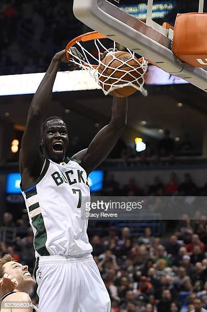 Thon Maker of the Milwaukee Bucks dunks against the Boston Celtics during the second half of a game at the BMO Harris Bradley Center on January 28...