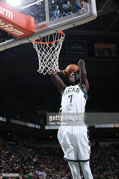 Thon Maker of the Milwaukee Bucks dunks against the Washington Wizards on December 23 2016 at the BMO Harris Bradley Center in Milwaukee Wisconsin...