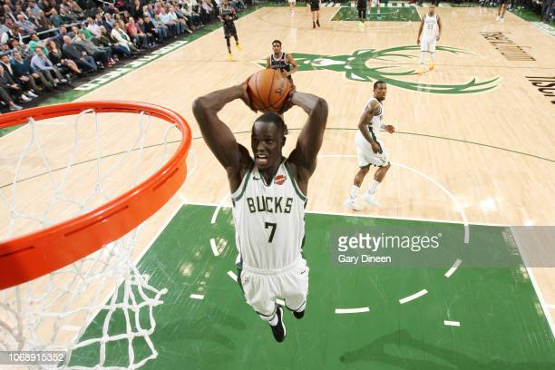 Thon Maker of the Milwaukee Bucks dunks the ball against the Detroit Pistons on December 5 2018 at the Fiserv Forum Center in Milwaukee Wisconsin...